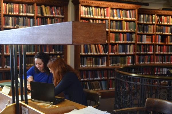 Two students studying in the History Faculty Library
